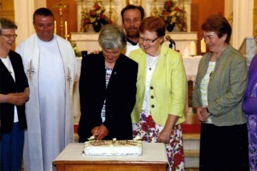 Cutting cake with Fr. T.